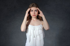 Pain, illness, discomfort concept. Woman put her hands to her te Stock Photography