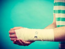 Man with painful bandaged hand. Royalty Free Stock Photo