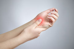 Pain in the joints of the hands. Care of female hands stock photos