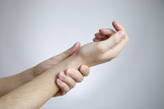 Pain in the joints of the hands Stock Images