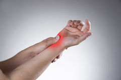 Pain in the joints of the hands Stock Photography