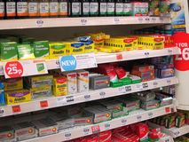 Pain killers on a superstore shelf. Rows of painkiller tablets on the shelves of a supermarket. These medicines are on the shelves of the Sainsbury Supermarket Stock Photo