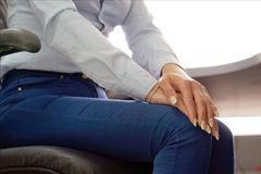 Pain in the knees of a woman. Pain In Knee. Close-up office worker Female Leg With Painful Knees. Woman Feeling Joint Pain, Having Health Issues And Touching Leg Royalty Free Stock Image