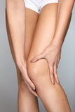 Pain In Knee. Closeup Of Female Leg With Painful Feeling In Knee Stock Photography