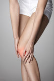 Pain In Knee. Closeup Of Female Leg With Painful Feeling In Knee Stock Photo