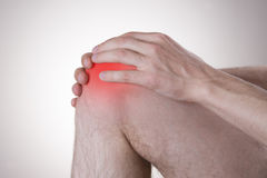Pain in the knee stock image