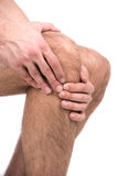 Pain in a knee. Man suffering from knee pain Stock Photos