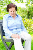 Pain in a knee. Senior woman with her hands on a painful knee stock photos
