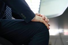Pain in the knees of a men. Pain In Knee. Close-up office worker male Leg With Painful Knees. Men Feeling Joint Pain, Having Health Issues And Touching Leg With Royalty Free Stock Images