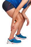 Pain in the Leg. Female jogger with pain in her lower leg, isolated in white Stock Images