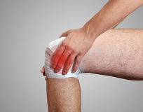 Pain in leg. The bandage Royalty Free Stock Image