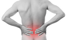 Pain in the lower back in men stock photos