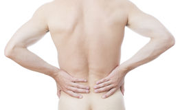 Pain in the lower back in men.  Royalty Free Stock Image