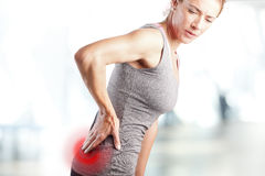 Pain in lower back Stock Photography