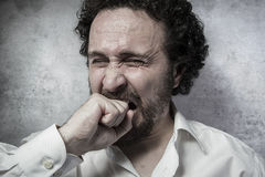Pain, man in white shirt with funny expressions Royalty Free Stock Photo