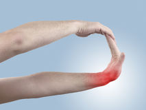 Pain in a man wrist Stock Photo