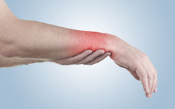 Pain in a man wrist Stock Photography