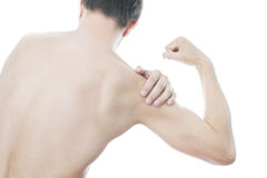 Pain in the men's shoulder Royalty Free Stock Images