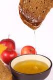 Pain, miel et pommes Images stock
