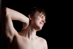 Pain in the neck. Young person is experiencing pain in the neck Royalty Free Stock Photography