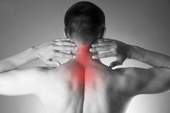 Pain in the neck. Man with backache. Pain in the man's body. Black and white photo with red dot royalty free stock images