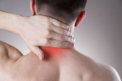 Pain in the neck. Man with backache. Pain in the man's body Royalty Free Stock Photos