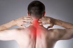 Pain in the neck. Man with backache. Pain in the man's body Royalty Free Stock Photo