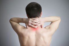 Pain in a neck of the man Stock Images