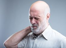 Old man having pain in the neck Stock Images