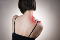 Pain in neck of women. Pain in the neck of women. Touching the neck Stock Photo