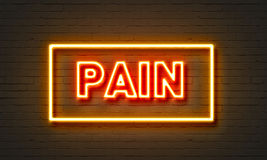 Pain neon sign on brick wall background. Stock Photography