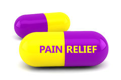 Pain Relief. Two yellow and purple pill capsules with the words Pain Relief written on one of them set against a white background Stock Photos