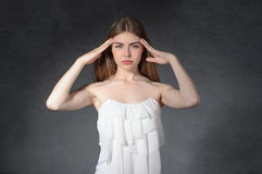 Pain, sadness, discomfort concept. Woman put her hands to her te Royalty Free Stock Photos