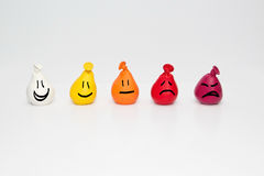 Pain assessment and measurement Chart for Children. Doodle Smiley faces on small color gradation balloons. Stock Photos