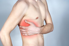 Pain in the side Royalty Free Stock Photo