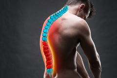 Pain in the spine, a man with backache, injury in the human back, chiropractic treatments concept. With highlighted skeleton stock photo