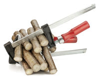 Pain, stress, pressure concept. Wooden logs are clamped in clamps.  Pain, stress, pressure concept Royalty Free Stock Photo