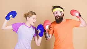 Pain is temporary, Pride is forever. training with coach. Happy woman and bearded man workout in gym. sportswear. Fight stock photography