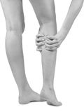 Pain in woman hamstring Stock Photography