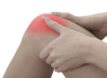 Pain in a woman knee Stock Photography