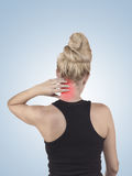 Pain in woman neck. Stock Photos