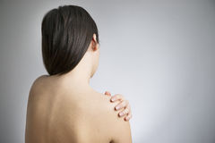 Pain in the women's shoulder Stock Photo