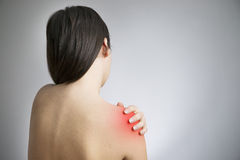 Pain in the women's shoulder Stock Photos