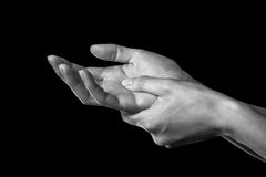 Pain in the wrist. Woman holds her hand, pain in the wrist, black and white image Stock Images