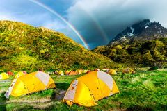 Double Rainbow and camping tents in Patagonia royalty free stock images