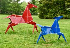 Pained Ponies. This is a Spring picture of two of the five Painted Ponies, which as part of the Origami in the Garden exhibit at Morton Arboretum located in Royalty Free Stock Photography