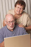 Pained Senior Adult Couple on the Computer Royalty Free Stock Photos