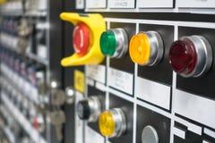 Painel de controle do foco seletivo com lotes dos botões Fotos de Stock