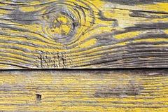 Painel de madeira amarelo gasto Imagens de Stock