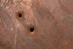 Painel oxidado com buracos de bala Fotografia de Stock